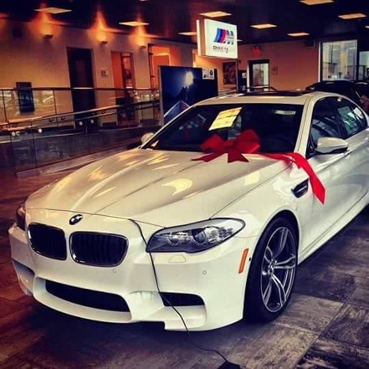 White BMW with red ribbon