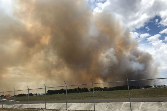 A fire near Tomago is heading east towards Newcastle Airport